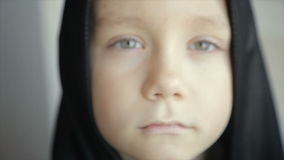 Close-up of a boy in a black hood stock video footage