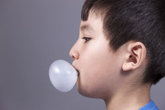 Close up of boy blowing bubble. Royalty Free Stock Images