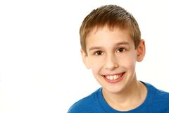 Close up of boy in blue shirt Stock Image