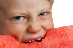 Close-up of boy devouring water melon Royalty Free Stock Photos