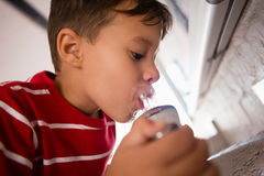 Close up of boy drinking water Royalty Free Stock Images
