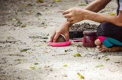 Kid plan sand in the park. Close up boy hand are grinding sand under light and shade in tha park stock images