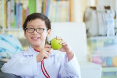 Close up of boy hands with green apple, Little cute boy future d royalty free stock photo