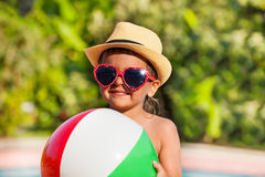 Close-up of boy in hat and sunglasses holding ball Royalty Free Stock Photography