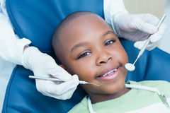 Close up of boy having his teeth examined Stock Images