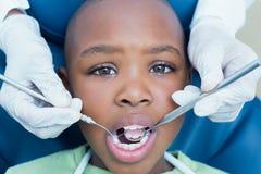 Close up of boy having his teeth examined Royalty Free Stock Photos