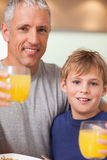 Close up of a boy and his father having breakfast Stock Photography