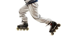 Close up a Boy Legs in Roller Skates Stock Images