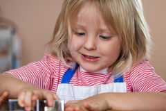 Close-up of boy making gingerbread cookie Stock Images