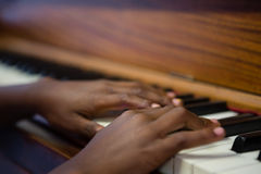 Close up of boy playing piano in classroom Stock Photos