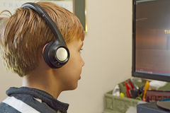 Close-up of Boy Playing Video Games on Computer Royalty Free Stock Photos