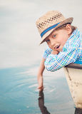 Close up boy portrait in old boat Royalty Free Stock Photo
