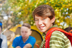 Close-up of boy with rucksack near yellow tent Stock Photos