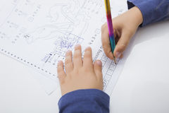 Close-up of boy's hand writing on paper Stock Images