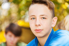 Close-up of boy sitting near yellow tent Stock Photography