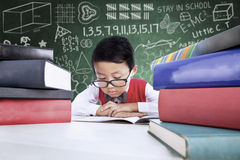 Close-up boy student reading books in class Stock Photo