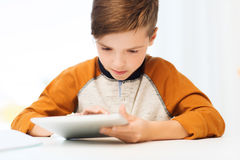 Close up of boy with tablet pc computer at home Stock Photo