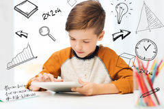 Close up of boy with tablet pc computer at home Royalty Free Stock Photography
