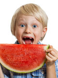 Close-up of boy taking bite of water melon Royalty Free Stock Photography