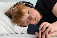 Boy Using Smartphone royalty free stock images