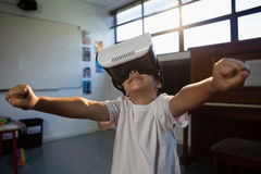 Close up of boy wearing virtual reality with arms raised Stock Photos