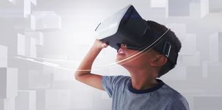 Close-up of boy wearing VR headset. Against white background Stock Images