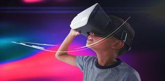 Close-up of boy wearing VR headset. Against white background Stock Photo