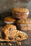 Bran muffins close-up view. Close up of a bran muffins with crumbs and muffins in the background Royalty Free Stock Photography