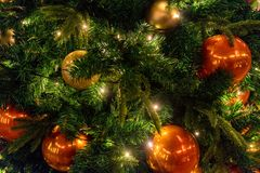 Frame of colorful Christmas decorations on tree stock photo