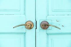 Close up Brass door handle at wood blue door Stock Image
