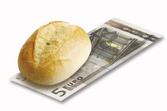 Close up of bread roll on 5 euro note on white background Royalty Free Stock Image