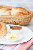 Close up of bread rolls with butter and jam Stock Photography