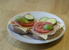Close up bread sandwich with ham cheese sliced cucumbre tomatoes Royalty Free Stock Photo