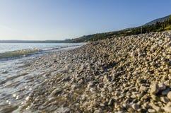 Close-up break on lourdata stones beach. Close-up at sunset of surf on pebble beach lourdata on the island of kefalonia close to the city of argostoli main town stock photos