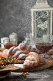 Close up. Breakfast with freshly baked french croissants, powdered on top white sugar powder. Winter fairytale morning. Copy space royalty free stock photos
