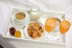 Close up of breakfast on tray in bed Royalty Free Stock Photography
