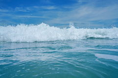 Close up on breaking wave viewed from sea surface Royalty Free Stock Photo