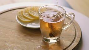 Close up of brewing black tea stock footage