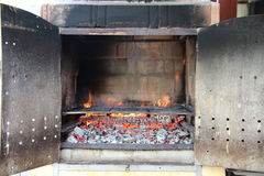 Close up on brick barbecue with flames ready to be used Stock Photo