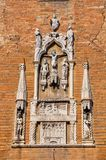 Close-up of brick made facade of an old church with sculptures in marble. At the city center of Venice. Stock Photo