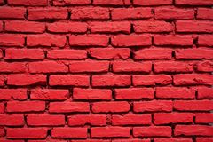Close-up of a brick wall painted red Stock Image