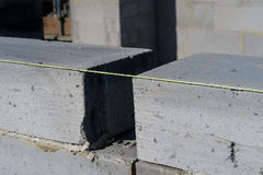 Close up of bricklayer's brick line string and bricks. Stock Photography