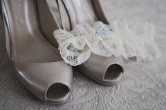Close up of bridal wedding shoes with garter on. Close up of bridal wedding shoes with garter Royalty Free Stock Photography