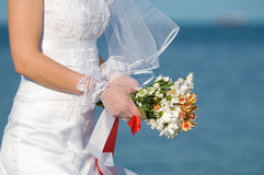 Close-up of bride with flowers Stock Photo