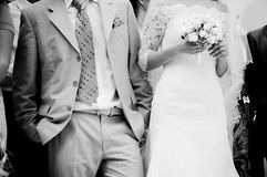 Close-up of bride and groom. Waiting for the ceremony, grayscale Stock Photos