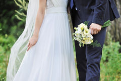 Close up of bride and groom hands. Wedding bouquet Royalty Free Stock Image