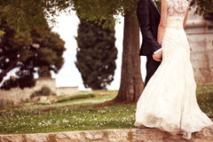 Close up of a bride and groom holding hands Royalty Free Stock Images