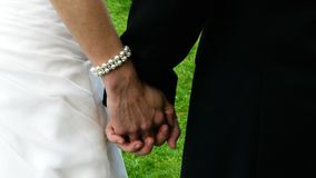 Bride and groom. Close up of a bride and groom holding hands stock video footage