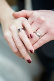Close Up Of Bride And Groom Wearing Wedding Rings Stock Image