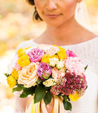 Close up of bride hands holding beautiful autumn wedding bouquet. Stock Photos